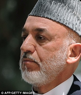 President Obama received condolences following the deaths from Afghanistan president Hamid Karzai, right