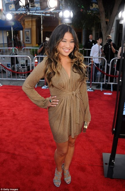 Cheeky:Jenna Ushkowitz puts her hand on her hip as she rocks the metallic look