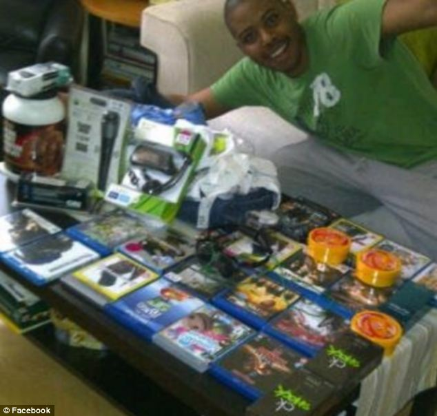 Don't show your Facebook: A brazen Londoner posted a picture of himself with items still in their packaging. Police say such postings encouraged other people to join in the looting