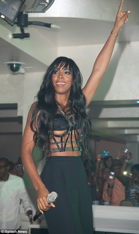 We salute you: Kelly smiles at her fans completely unaware of her wardrobe mishap