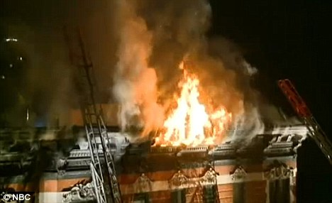 Raging: The building in the SoHo area of New York had to be evacuated as fire crews fought the blaze