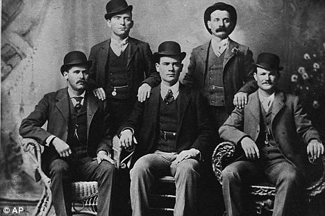 Wild times: This is a famous photo taken of Cassidy and his gang in Fort Worth, Texas in 1900. This is said to show Bill Carver, top left, the Sundance Kid, bottom left, and Butch Cassidy, bottom right. The other two members of the gang are not identified