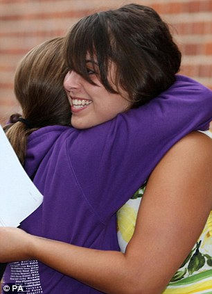Danielle Eddington is congratulated by a friend as she picks up her exam results from Chelmsford County High School For Girls in Essex