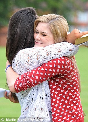 Abbi McKenna and Rebecca Livesey celebrate their A grades in Manchester