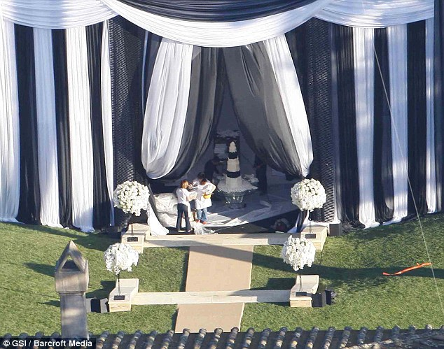 Dessert: The ten-tier black and white wedding cake is put in place inside the enormous marquee