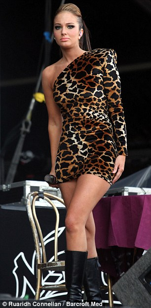 7541fe5d04 Feline fine  Wearing a tight leopard print dress