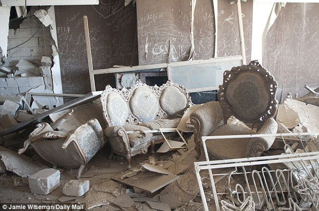 Trashed: Debris from reproduction furniture litters one of dictator's palaces within the compound