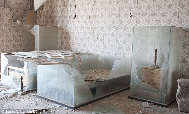 Smashed: These glass cases protected the bed of Gaddafi's adopted daughter Hana, whose bedroom was a shrine following her death during a 1986 U.S. air strike