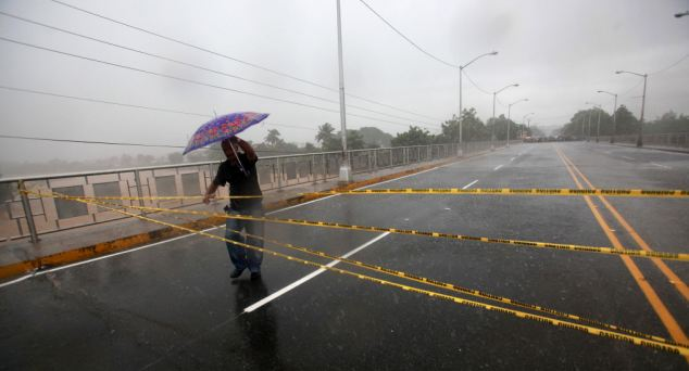 Stuck: A man tries to cross the Sanchez bridge which was closed by Dominican Army, in San Cristobal, Dominican Republic