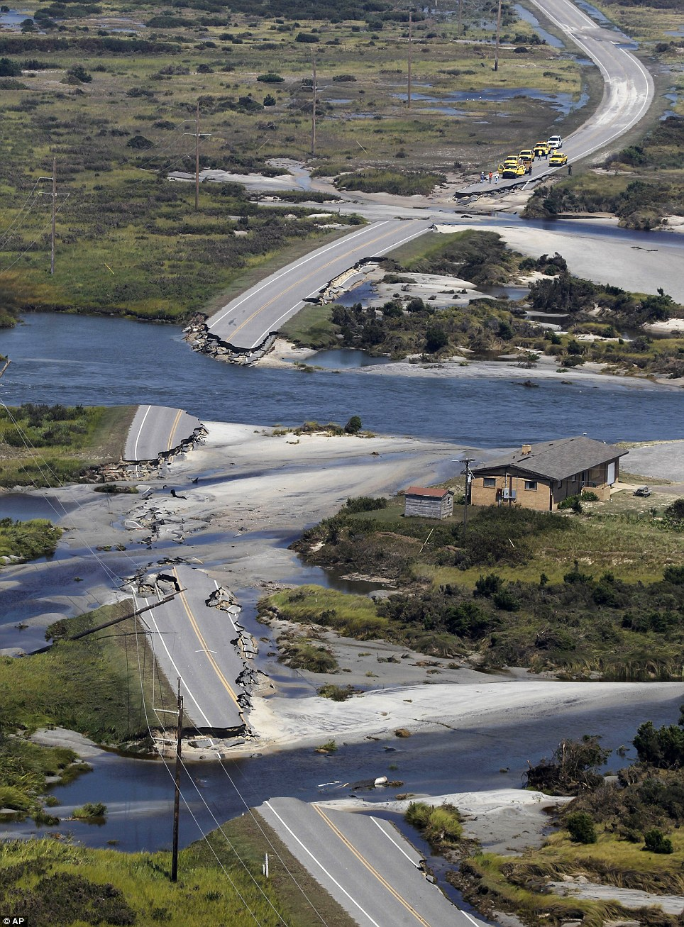 Destruction: Route 12 on Hatteras Island, North Carolina yesterday after Irene swept through the area, cutting the roadway in five locations