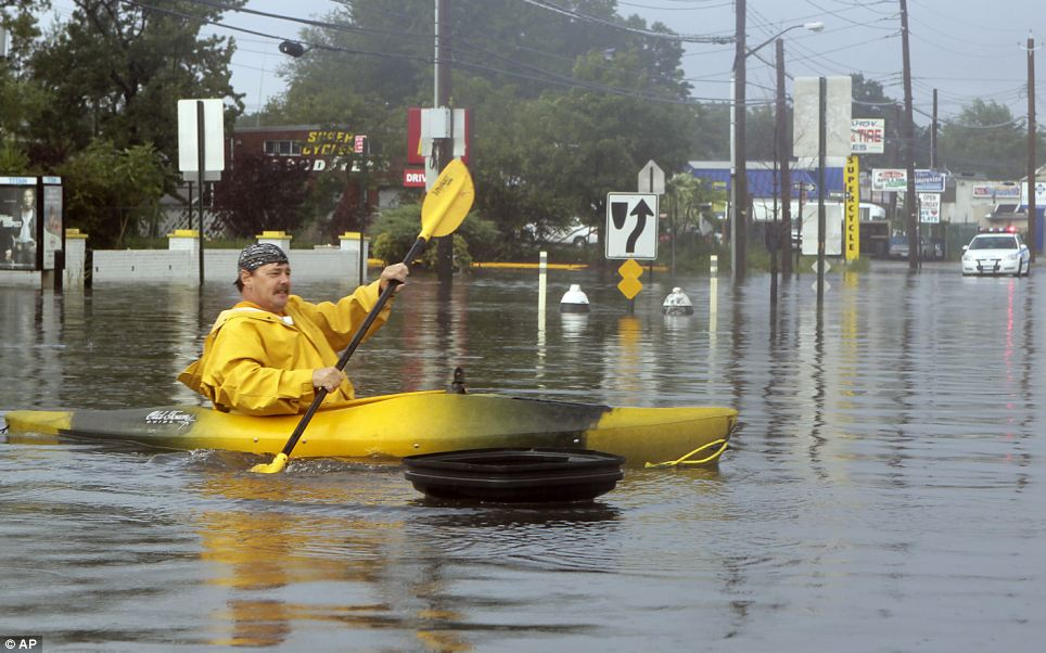 Paddling: Kevin Holligan, of the Staten Island borough of New York, kayaks across a flooded section of the borough's Hyland Boulevard