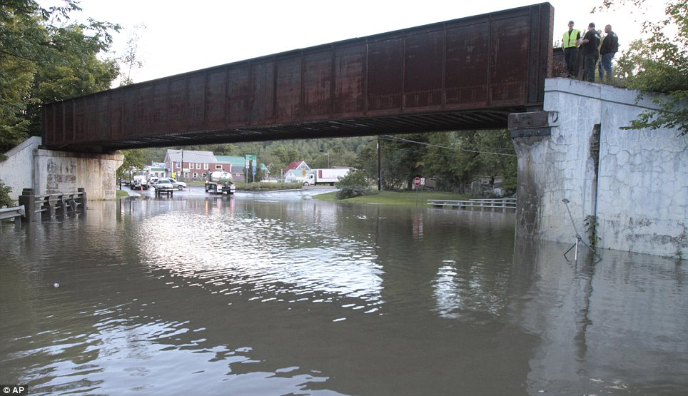 Water everywhere: Floodwaters cover Main Street in the aftermath of Tropical Storm Irene in Waterbury, Vermont