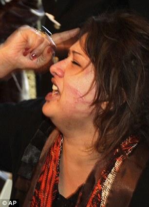 Distress: Iman Al-Obeidi claimed she had been raped by Gaddafi's men when she rushed into the Rixos hotel in Tripoli