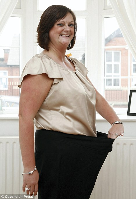 Virtual gastric band: Kim Robinshaw, of Lancashire, was hypnotised into thinking she had the surgery and has lost almost 8 stone