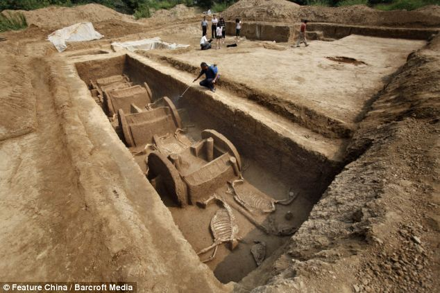 Exciting find: Archaeologists say this is the most<br /> complete find of any tomb of its era. The wooden chariots have<br /> completely rotted away, with only the ash residue remaining