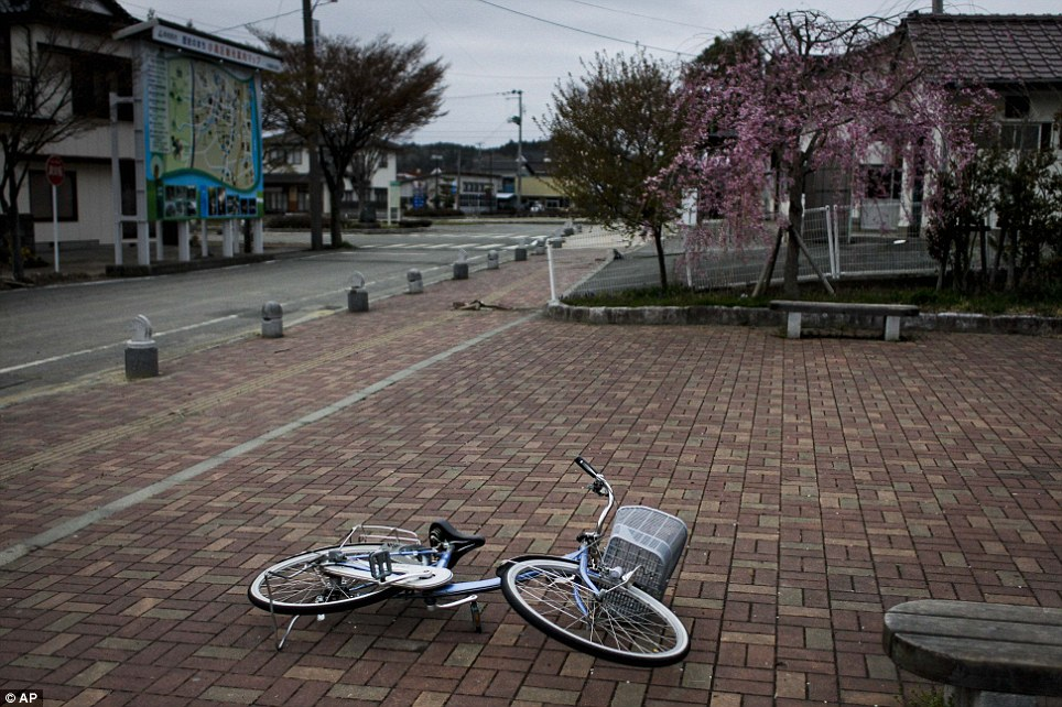 A fallen bicycle lies on a Futaba pavement. The Fukushima disaster released about 15 per cent of the radiation that escaped from the Chernobyl reactor in Ukraine in 1986