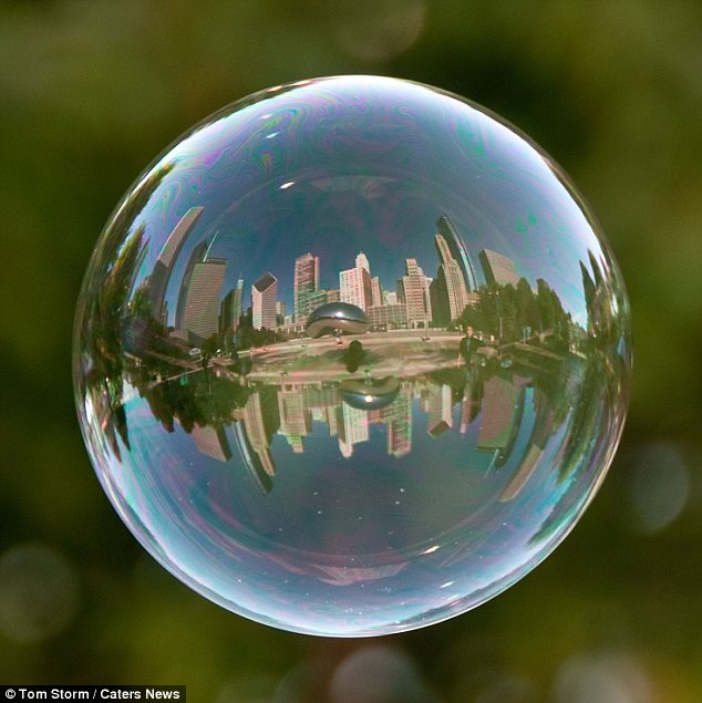 World in a bubble: Cloud Gate in Chicago is reflected in this photograph