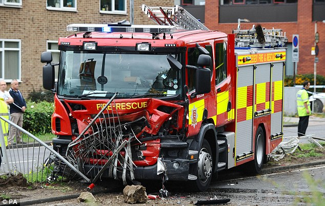 Devastation: The crumpled fire engine after it collided with a woman's car in Basildon, Essex