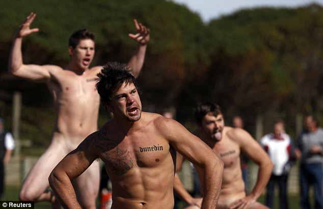 Naked rugby players from the Nude Blacks perform the Haka before their match against a Spanish ladies' side