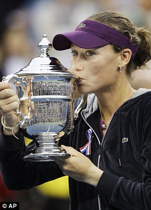 Champion: Samantha Stosur kisses the US Open trophy after beating Serena Williams