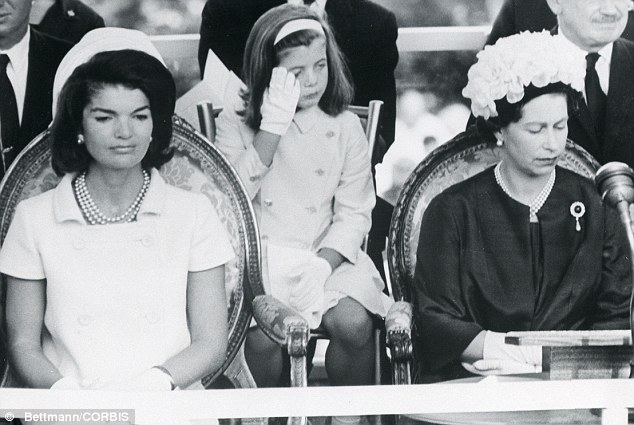 Memorial: Jackie and her daughter Caroline, centre, with Queen Elizabeth II at a ceremony for JFK in Runnymede, England