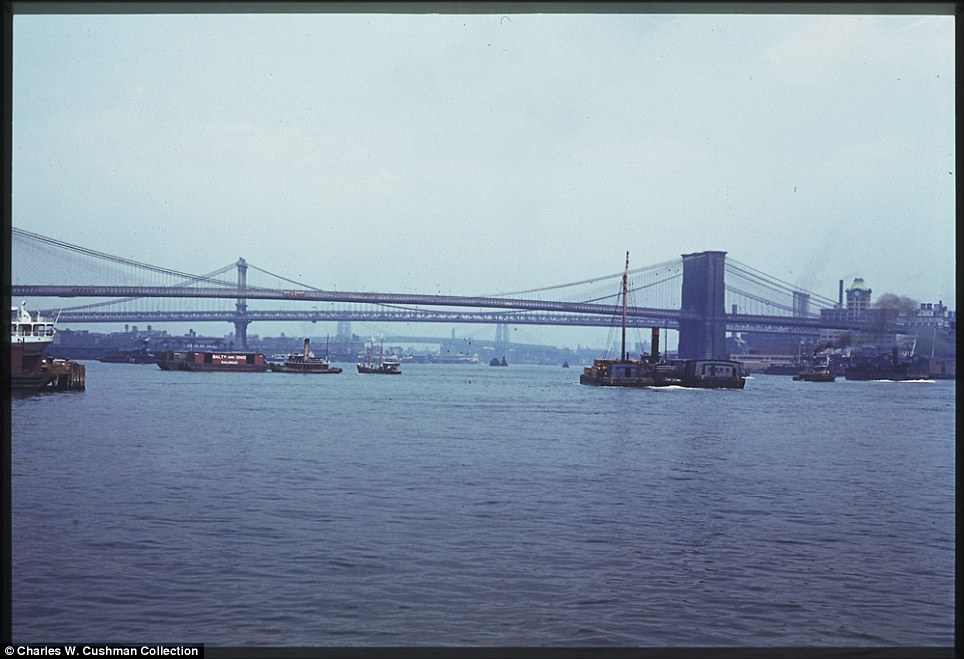 Crossing: The East River is pictured below Brooklyn Bridge, linking Brooklyn and Manhattan, on June 6, 1941