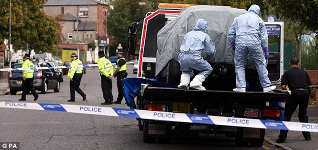 Police forensic officers cover a car in Birmingham following the arrests of six men in Birmingham as part of a large intelligence-led counter-terrorism operation