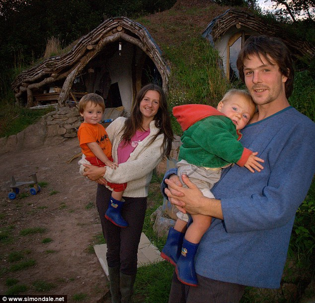 Finished article: Simon Dale, with wife Jasmine Saville, outside their home, just four months after starting work