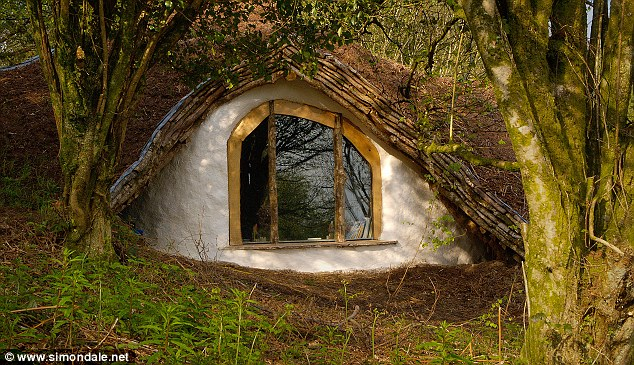 Hobbit house: The finished article sits in the Welsh hillside and is almost hidden from view