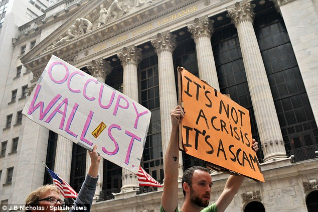 Signs: The 'Occupy Wall Street' protest in Manhattan, New York, has been going on since the weekend