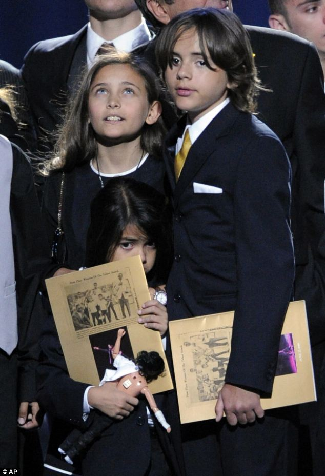 Their say: Paris and Prince Jackson, pictured with younger brother Blanket at their father's memorial service, want to give their account of the day their father died