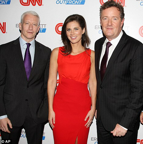 Thrilled: Clearly overjoyed, she also posed with several of her colleagues, including Piers and Anderson