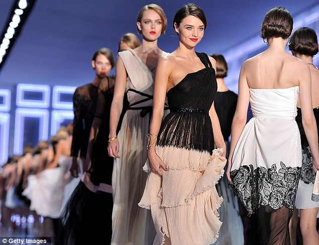 Stealing the show: The Australian supermodel looked stunning in asymmetrical gown, featuring a pale pink tiered skirt with a black lace top overlay