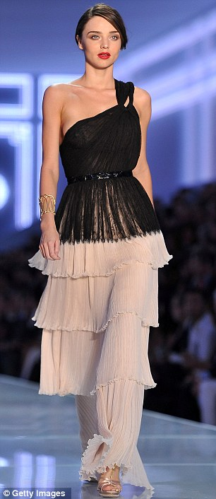 Catwalk queen: Miranda Kerr took to the runway today for Christian Dior's at Paris Fashion Week and right, later modelled for Lanvin
