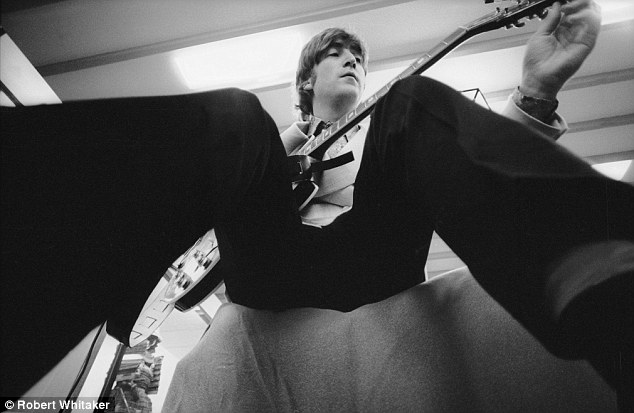 Different viewpoint: John Lennon pictured backstage in Japan in 1966. The Beatles enjoyed working with Whitaker because of his unorthodox, experimental approach to photography