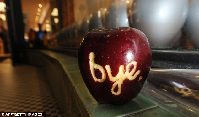 Tribute: A apple with the word 'bye' carved into it sits outside an Apple store in Pasadena, California