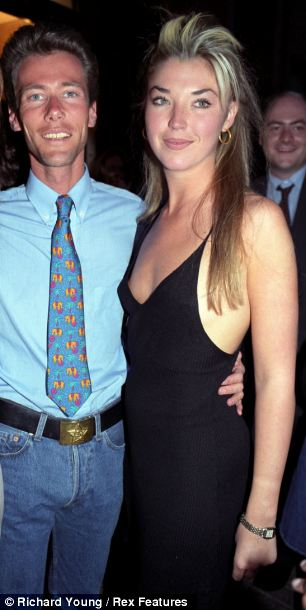 Blonde ambition: Eddie shows off a trademark metal belt buckle with Tamara Beckwith in 1994