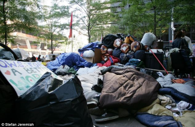 Pile: The rubbish has been building up in Zuccotti Park for days now