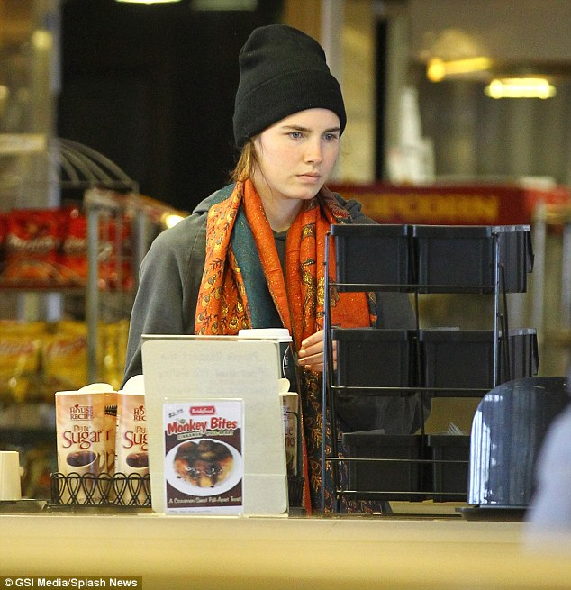 Wrapped up: Knox later put on woolly hat, coat and brightly coloured scarf and was seen buying more snacks as she took a ferry trip with her family