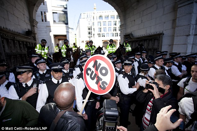 Protesters stand outside St Pauls Cathedral at the beginning of Occupy The London Stock Exchange