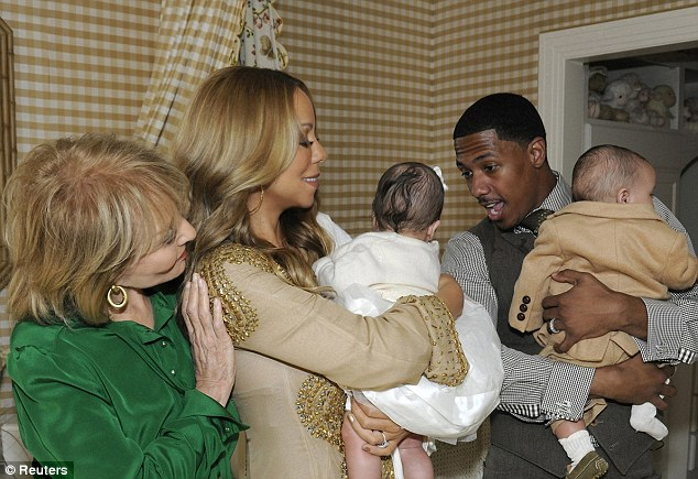 Double the joy: Mariah Carey and husband Nick Cannon are pictured with their twins Monroe and Moroccan during an interview with Barbara Walters