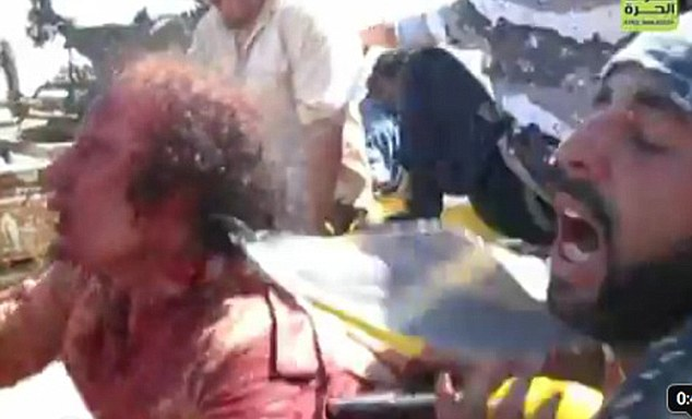 Terrified: Gaddafi pleaded for his life after he was captured by rebel fighters