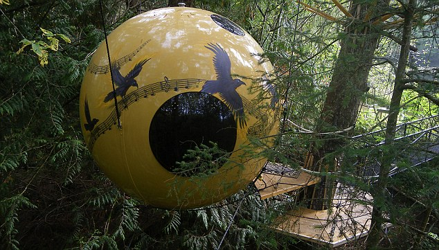 Free as a bird: The spheres sway gently in the breeze and are suspended 10 ft above the forest floor