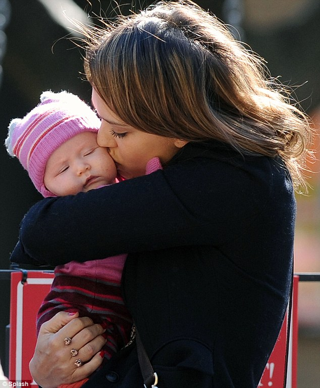Doting mother: Jessica Alba kisses her baby Haven lovingly while at the park, along with her eldest daughter Honor, three