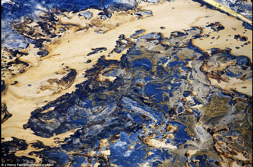 Devastation: This shows oil from sand extraction at Fort McMurray, Alberta, Canada. After the bitumen is removed, vast quantities of 'tailings' remain, which are the residue containing everything but the bitumen