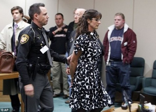 Jailed: Stacy Schuler, a former gym teacher, is lead out of the courtroom after being convicted for four years in Lebanon, Ohio for having sex with five students