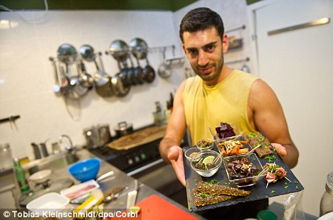 Back to basics: Sauvage kitchen assistant Kawan Lofti holds a dish made entirely of ingredients which our Stone Age ancestors would have used