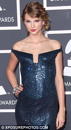Protecting Taylor: Swift's legal team is threatening legal action against a website claiming it has a topless photo of the singer