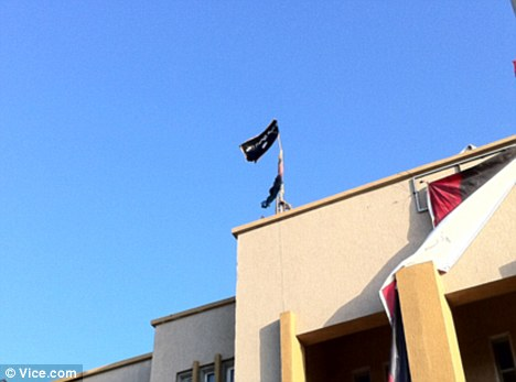 Alqaeda flag above courthouse in post Gaddafi Libya