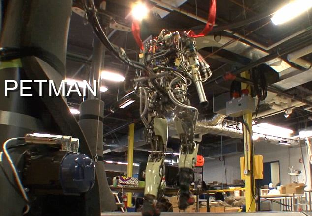 Petman walks across a treadmill. There is one tiny cheat - the war droid is held up by two metal cables... but so was Boston Dynamic's earlier BigDog in its first demos